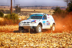 HD - BMW truck kicking up dust on turn ar rally Royalty Free Stock Images