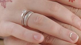 HD close up shot of hands in hands of bride and groom stock video footage