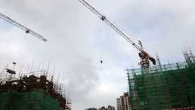 HD - Construction crane moving in a building construction site stock video footage