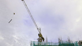 HD Construction crane moving in a building construction site stock video footage