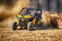 HD - Custom twin seater rally buggy kicking up trail of dust on Stock Photo