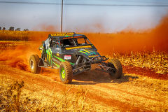HD - Custom twin seater rally buggy kicking up trail of dust on Royalty Free Stock Photography