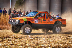 HD orange truck kicking up dust on turn ar rally Stock Images