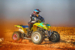 HD- Quad Bike kicking up trail of dust on sand track during rall Royalty Free Stock Photography