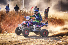 HD- Quad Bike kicking up trail of dust on sand track during rall Royalty Free Stock Images