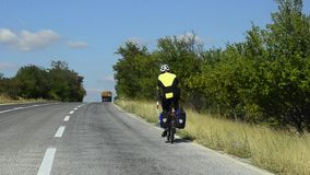 HD:Road Traveler Uphill Cycling. HD1080 Biker cycling uphill on public road traveling around stock video footage