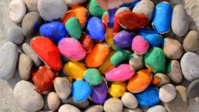 HD 1080 staining gray stones in different colors with brush and colored paint. HD 1080 staining gray smooth stones in different colors with brush and colored stock footage