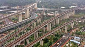 HD time lapse - Aerial view of a complex road junction and overpass stock video footage