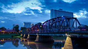 HD Time lapse Day to night Iron Bridge. The iron bridge landmark of Chiang Mai Thailand time-lapse  with colorful of LED light stock video footage