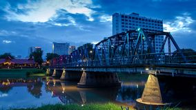 HD Time lapse Day to night Iron Bridge. The iron bridge landmark of Chiang Mai Thailand time-lapse  with colorful of LED light stock footage