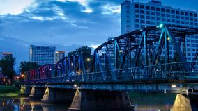 HD Time lapse  Iron Bridge day to night. The iron bridge landmark of Chiang Mai Thailand time-lapse  with colorful of LED light stock video footage