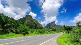 HD Time lapse. Mountain Road, moving clouds stock video footage