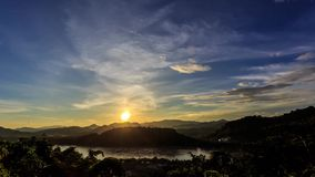 HD Time lapse. Sunset, moving clouds over the river. Moving clouds over Mekong river at sunset. View from Mountain Phousi, Luang Prabang, Laos stock video footage
