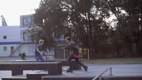 HD Trio: Biker, Skater, Roller skater are doing tricks on the ground stock footage