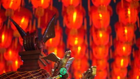 HD video of Taiwan buddhist temple ornament in front of Thousand of Chinese red lanterns background. Video of Taiwan buddhist temple ornament in front of