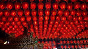 HD video of Thousand of Chinese red lanterns. Illuminate lamps to celebrate Chinese New Year. Beautiful night scene of temple in T. Video of Thousand of Chinese