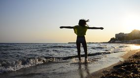 HD: Young girl Spinning on Beach At Sunset, stock footage