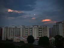 HDB Flats Sunrise Bright on Dark Cloud royalty free stock photography
