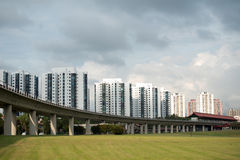HDB Homes and Transit (MRT) Line in Singapore. This image shows HDB Homes and Transit (MRT) Line in SIngapore Royalty Free Stock Photography