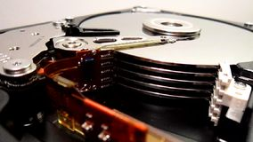 HDD - Hard Disk Drive is open, broken and spin out stock video