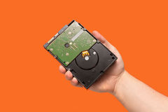 HDD Hard disk drive on orange background. Front view Royalty Free Stock Photography