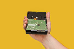 HDD Hard disk drive on yellow background. Front view Stock Image