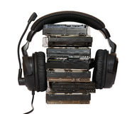 HDD with headphones. Pile HDD with headphones on top Royalty Free Stock Image