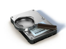 HDD and magnifying glass Stock Images