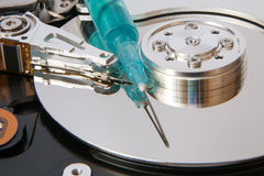 Hdd and a syringe Royalty Free Stock Images