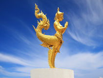 Kinnara. In Buddhist mythology and Hindu mythology, a kinnara is a paradigmatic lover, a celestial musician, half-human and half-horse (India) or half-bird ( Stock Photography