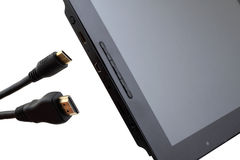 HDMI cable and tablet pc. Tablet pc and an HDMI cable on a white background Stock Photo