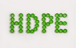 HDPE High-density polyethylene lettering composed of caps from plastic beverage bottles. Recycling. Recycling. HDPE High-density polyethylene lettering composed royalty free stock image