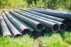 HDPE pipe for water supply at construction site construction of a water supply system plastic pipes for water supply of the city royalty free stock image