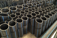HDPE pipes in the factory. HDPE pipes waiting for examining in the industry factory, cutting pipe for inspecting with high quality control Royalty Free Stock Photo