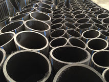 HDPE pipes in the factory. HDPE pipes waiting for examining in the industry factory, cutting pipe for inspecting with high quality control Stock Photos