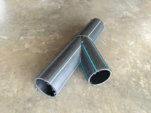 HDPE pipes, Y type. HDPE Pipe Fittings Y type lay down on the concrete floor in the industrial factory Royalty Free Stock Photos