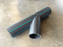 HDPE pipes, Y type. HDPE Pipe Fittings Y type lay down on the concrete floor in the industrial factory Stock Photo