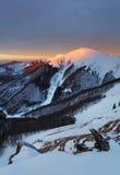 hdr图象横向庄严山日落冬天 严重的天空 库存图片