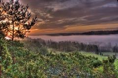 在HDR的山有雾的风景 库存图片