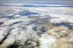 HDR Aerial photo of the japanese landscape with clouds, mountains and landscape with snowy patches Royalty Free Stock Photos