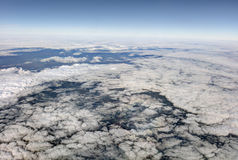 HDR Aerial photo of the landscape with clouds, snowy mountains and view stretching all the way to the horizon Stock Photography