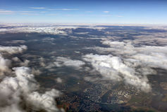 HDR Aerial photo of the landscape with clouds, snowy mountains and view stretching all the way to the horizon Stock Photos