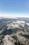 HDR Aerial photo of the landscape with clouds, snowy mountains and view stretching all the way to the horizon Royalty Free Stock Images