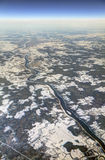 HDR Aerial photo of the landscape with clouds, snowy patches, a larger river in a canyon Stock Image