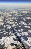 HDR Aerial photo of the landscape with clouds, snowy patches, a larger river in a canyon Stock Photography