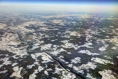 HDR Aerial photo of the landscape with clouds, snowy patches, a larger river in a canyon Royalty Free Stock Photography