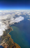 HDR Aerial photo of the landscape and coastline with clouds, snowy mountains and view stretching all the way to the horizon Stock Image