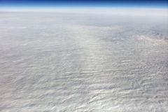 HDR Aerial photo of the landscape under a cloud cover and view stretching all the way to the horizon Stock Photo