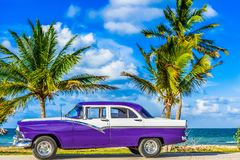 HDR - American blue classic car parked on the Malecon near the beach in Havana Cuba - Serie Cuba Reportage.  Royalty Free Stock Photos