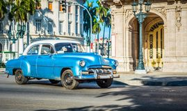 HDR - American blue classic car with white roof drived on the main street in Havana City Cuba - Serie Cuba Reportage Stock Photography